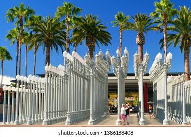 Los Angeles, CA, USA July 24, 2014 Visitors walk amongst Urban Lights are a poplar art installation by Chris Burden in Los Angeles