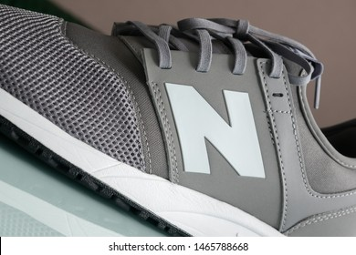 """Los Angeles, CA, USA - July 25, 2019: Close-up of New Balance white """"N"""" logo on grey 247 modern running sneakers with REVlite sole"""