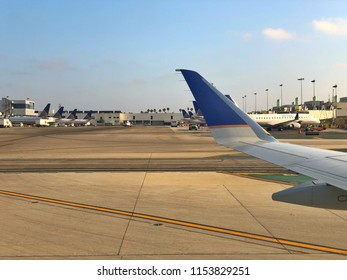 LOS ANGELES, CA, USA - JUN 24, 2018:  LAX Airport jetway with taxing aircrafts