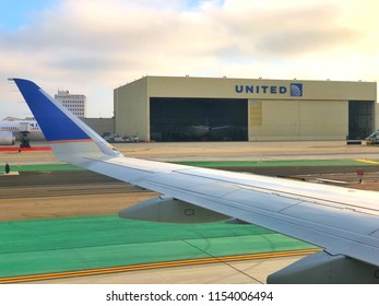 LOS ANGELES, CA, USA - JUN 24, 2018:  LAX Airport jetway with taxing United Ted aircrafts and building