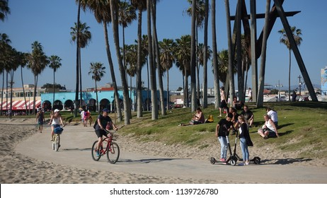 Los Angeles, CA / USA - June 7, 2018: People enjoy the bike path between Santa Monica and Venice Beach on a sunny day