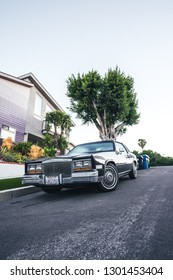 Los Angeles, CA USA - June 11 2018: Cadillac Eldorado Biarritz 1982 Coupe touring on the street, green tree on background