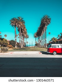 Los Angeles, CA USA - June 11 2018: Red Volkswagen T1 Retro Van, old timer, vintage hipster bus. Blue sky and palms on background