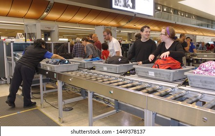 Los Angeles, CA / USA - June 12, 2019: People going through TSA security checkpoint at Los Angeles International Airport (LAX)