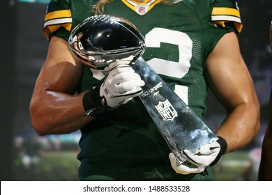 Los Angeles, CA/ USA - June 6, 2011: NFL football player Green Bay Packer Clay Matthews holds the Lombardi Trophy onstage during EA Sports 'Madden 12' demo at the 2011 EA E3 PresS Conference.