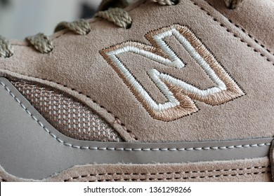 Los Angeles, CA, USA - March 28, 2019: Close-up of New Balance embroidered logo on 1500 suede sneakers made in England