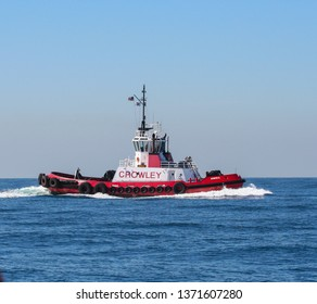 Los Angeles, CA / USA - March 3, 2006: A bright red Crowley Maritime Tractor Tug, ADMIRAL, Under Way In offshor of the Port Of Los Angeles and Long Beach, California, USA.