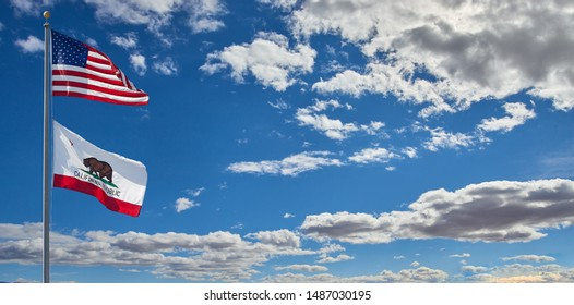 Los Angeles, CA / USA March 12 2019: American and California Republic Flags waving on pole isolated on clear blue sky background