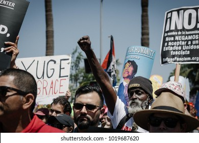 Los Angeles, CA / USA / May 1, 2017: An African-American protestor raises his fist at the Los Angeles May Day Resistance March.