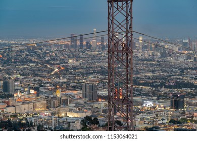 Los Angeles, CA, USA - May 26th, 2018: electrical power pylon and cables in front of view to skyscrapers located in Los Angeles.