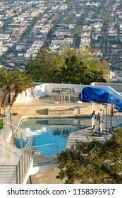 Los Angeles, CA, USA - May 26th, 2018: Scenic view to mountain hill with luxury beautiful buildings with water pool located in Los Angeles.
