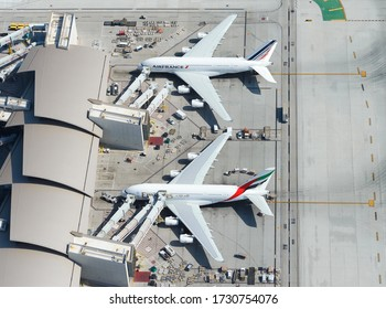 Los Angeles, CA / USA - May 30 2016: Air France and Emirates Airline Airbus A380 parked at Tom Bradley International Terminal in LAX airport. Aerial view of A380-800 aircraft also know as super heavy.