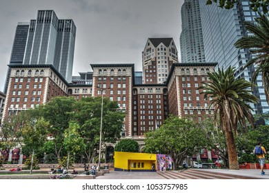 Los Angeles, CA, USA - October 27, 2016: People in Pershing square with Millenium Biltmore Hotel on the background