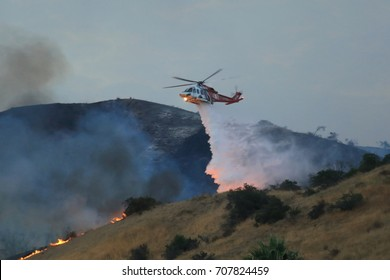 Los Angeles, CA / USA - Sept. 2, 2017: A Los Angeles Fire Department helicopter drops flame retardant on the La Tuna Fire that's burned over 8,000 acres (one of the largest fires in L.A. history.)