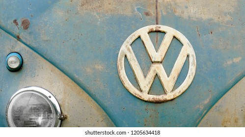 Los Angeles, CA / USA - September 25, 2018: Retro Volkswagon van with vintage rusty VW emblem logo and old dirty scuffs and scratches.