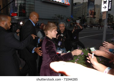 "LOS ANGELES, CA-FEBRUARY 8 : Actor/singer Justin Bieber arrives at the premiere of his movie ""Never Say Never 3D"" held at Nokia Theater, February 8, 2011 in Los Angeles, CA."
