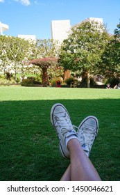 Los Angeles, California – 09/08/2013:  Crossed legs of a girl in Garden at Getty Center, Los Angeles, California, United States
