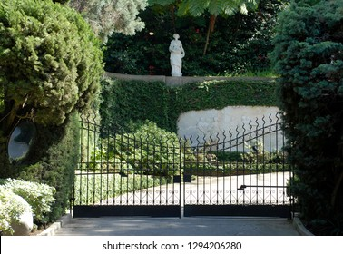 Los Angeles, California - April 19, 2015: The entrance gate to the Playboy Mansion in the Holmby Hills area of Los Angeles. Playboy founder Hugh Hefner lived there from 1974 until his death in 2017.