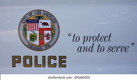 LOS ANGELES, CALIFORNIA - April 19, 2017: Close up of the symbol of the Los Angeles Police Department on the door of a police car.