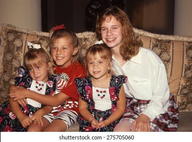 LOS ANGELES, CALIFORNIA - exact date unknown - circa 1990 - Mary Kate Olsen, Ashley Olsen, Jodie Sweetin and Andrea Barber of the sitcom Full House posing at charity event