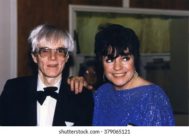 LOS ANGELES, CALIFORNIA - EXACT DATE UNKNOWN - CIRCA 1990 - very rare photo of Andy Warhol and Joanne Worley attending a celebrity event