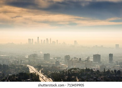 LOS ANGELES, CALIFORNIA - FEB 13: Sunrise towards a smog ridden Los Angeles downtown on February 13, 2016.  In addition to smog, Los Angeles is also well known for its film industry and sports teams.