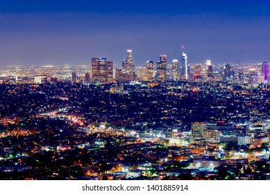 Los Angeles, California - February 13, 2019:Los Angeles, California - February 13 2019: panoramic view of the city of Los Angeles at night with illuminated skyscrapers and crowded streets of cars