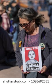 """LOS ANGELES, CALIFORNIA - FEBRUARY 19, 2018: A woman holds a sign """"I Stand With Emma We Call BS"""" sign at the People's Rally Against Gun Violence in Pershing Square."""