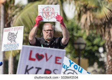 LOS ANGELES, CALIFORNIA - FEBRUARY 19, 2018: A supporter at the People's Rally Against Gun Violence in Pershing Square, NRA and bloody hands.