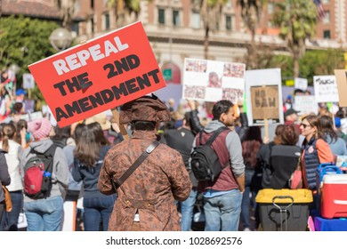 "LOS ANGELES, CALIFORNIA - FEBRUARY 19, 2018: ""Repeal the 2nd Amendment"" sign held by a protester at the People's Rally Against Gun Violence in Pershing Square."