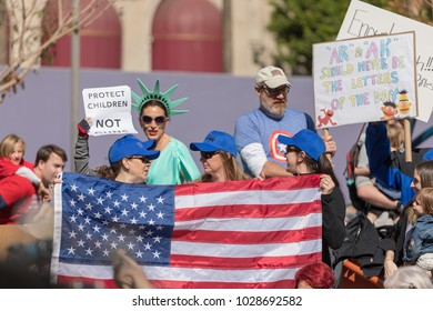 """LOS ANGELES, CALIFORNIA - FEBRUARY 19, 2018: """"Protect Children not guns"""" sign at the People's Rally Against Gun Violence in Pershing Square."""