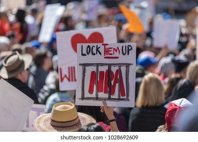 "LOS ANGELES, CALIFORNIA - FEBRUARY 19, 2018: ""Lock them Up NRA"" sign at the People's Rally Against Gun Violence in Pershing Square."