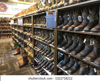 Los Angeles, California - February 8, 2019: A wide selection of boots in an American store during the end of season sales.
