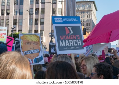 "LOS ANGELES, CALIFORNIA - JANUARY 20, 2018:  2nd Annual Women's March marcher  with a sign that reads, ""WGA Writers Guild of America West Women's March Los Angeles."""