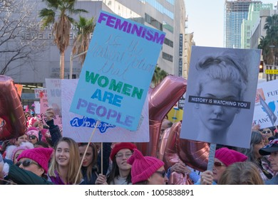 """LOS ANGELES, CALIFORNIA - JANUARY 20, 2018:  2nd Annual Women's March marcher  with a sign that reads, """"Feminism is the readical notion that women are people."""""""