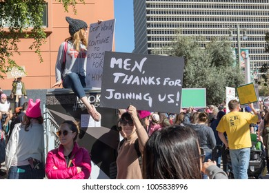"""LOS ANGELES, CALIFORNIA - JANUARY 20, 2018:  2nd Annual Women's March marcher  with a sign that reads, """" Men, thanks for joining us!"""""""