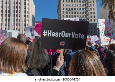 "LOS ANGELES, CALIFORNIA - JANUARY 20, 2018:  2nd Annual Women's March marcher holding sign that reads, hashtag, ""Hear Our Vote."""