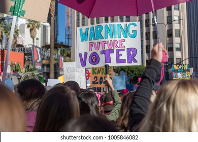 "LOS ANGELES, CALIFORNIA - JANUARY 20, 2018:  2nd Annual Women's March marcher holding sign that reads, ""Warning Future Voter."""
