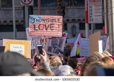 """LOS ANGELES, CALIFORNIA - JANUARY 21, 2018:  2nd Annual Women's March marcher with a sign that reads, """"Indivisible Love."""""""