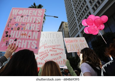"LOS ANGELES, CALIFORNIA - JANUARY 21, 2017: Women's March signs held by women that read ""Women's Rights are Human Rights"" and ""Women For Equality"""