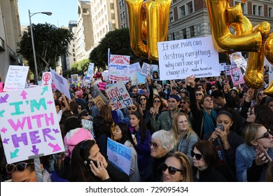 "LOS ANGELES, CALIFORNIA - JANUARY 21, 2017: One protester at the Women's March holds up a sign; ""If one man can destroy everything, why can't one girl change it."" a quote by Malala Yousafzai."