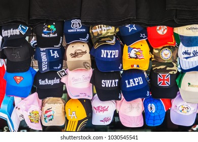 LOS ANGELES, CALIFORNIA - JULY 19, 2007 : Display of many different caps in a store along the boardwalk of Venice Beach, Los Angeles, California.