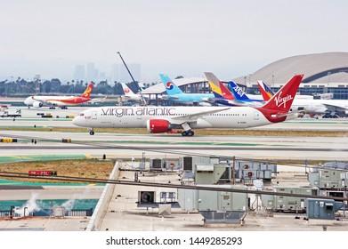 LOS ANGELES - CALIFORNIA, JUNE 1, 2019:  Virgin Atlantic Boeing 787 Dreamliner aircraft taxiing along the runway upon arrival at Los Angeles International Airport. Los Angeles, California USA