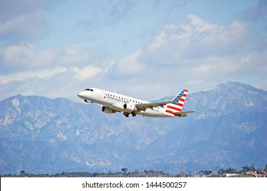LOS ANGELES - CALIFORNIA, JUNE 16, 2019: Compass Airlines (American Eagle) Embraer ERJ-175LR aircraft is airborne as it departs Los Angeles International Airport. Los Angeles, California USA