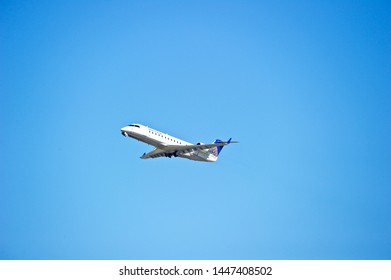 LOS ANGELES - CALIFORNIA, JUNE 16, 2019: SkyWest Airlines (United) Bombardier CRJ-200ER aircraft is airborne as it departs Los Angeles International Airport. Los Angeles, California USA