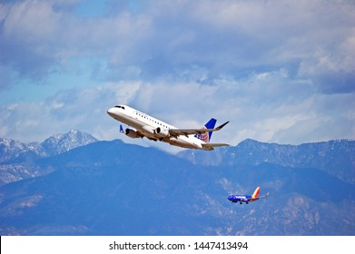LOS ANGELES - CALIFORNIA, JUNE 16, 2019: United Express Embraer ERJ-175LR aircraft is airborne as it departs Los Angeles International Airport. Los Angeles, California USA
