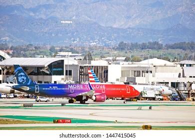 LOS ANGELES - CALIFORNIA, JUNE 16, 2019: Alaska Airlines Airbus A321 aircraft taxiing along the runway at Los Angeles International Airport. Los Angeles, California USA