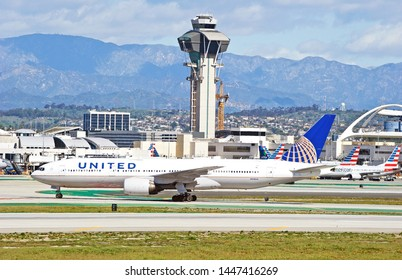 LOS ANGELES - CALIFORNIA, JUNE 16, 2019: United Airlines Boeing 777 taxiing along the runway upon arrival at Los Angeles International Airport. Los Angeles, California USA