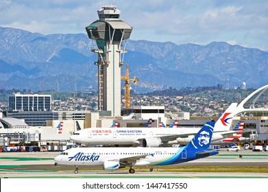 LOS ANGELES - CALIFORNIA, JUNE 16, 2019: Alaska Airlines Airbus A320 aircraft taxiing along the runway upon arrival at Los Angeles International Airport. Los Angelees,