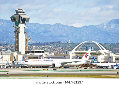LOS ANGELES - CALIFORNIA, JUNE 16, 2019: China Eastern Airlines Boeing 777 taxiing along the runway upon arrival at Los Angeles International Airport. Los Angeles, California USA